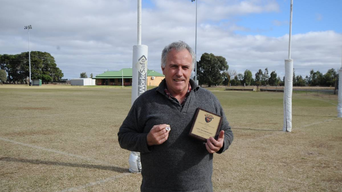 LIFE MEMBER: Greg Joyce with the medal and plaque he was given upon receiving his life membership. Picture: KLAUS NANNESTAD