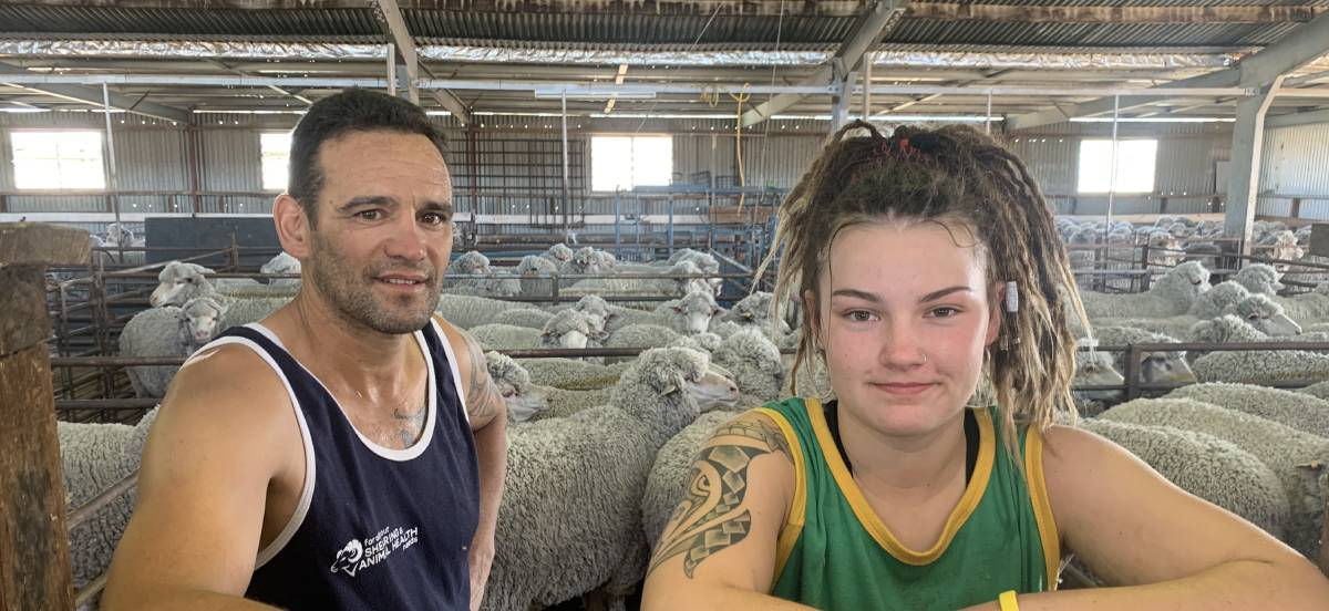 HARD WORK: Roger Pearse (left) and Elysia Musgrove (right) have been working as hard as possible to help overcome the shearer shortage in the region. Picture: TALLIS MILES