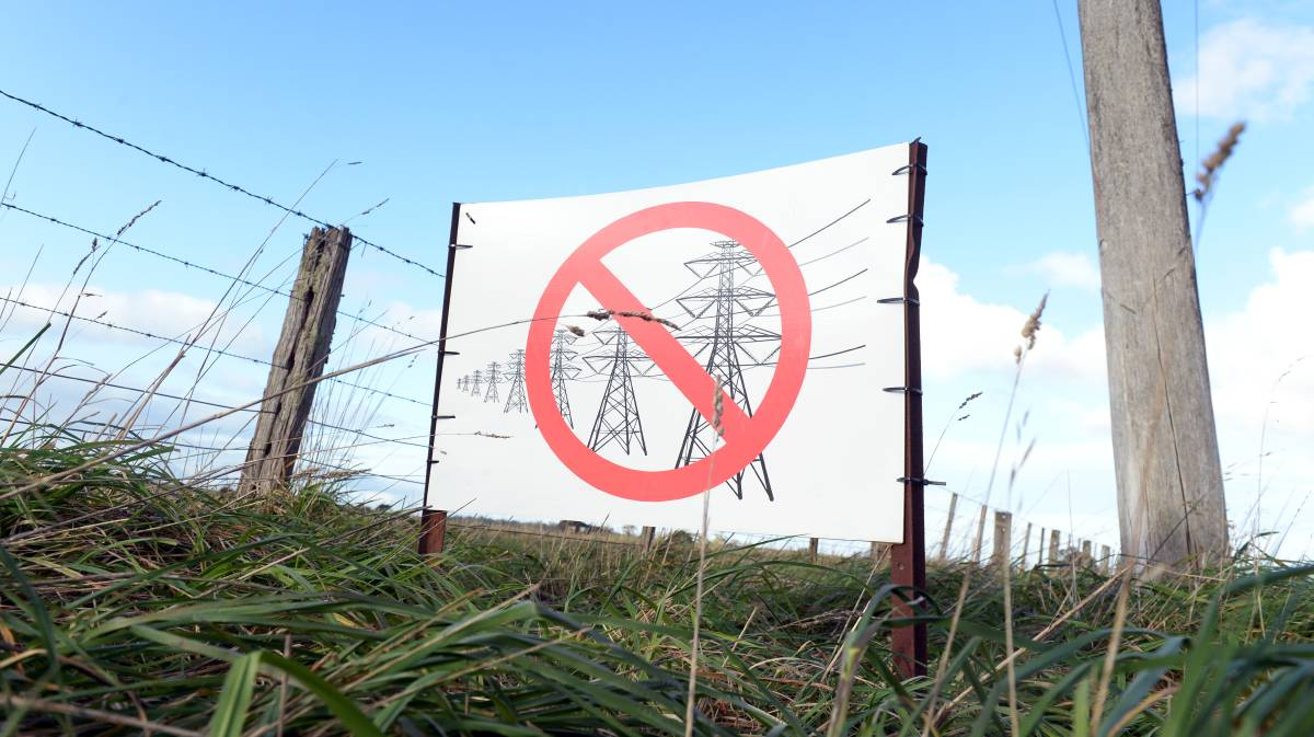 An anti-powerline sign spotted near Ballarat. Picture: Kate Healy