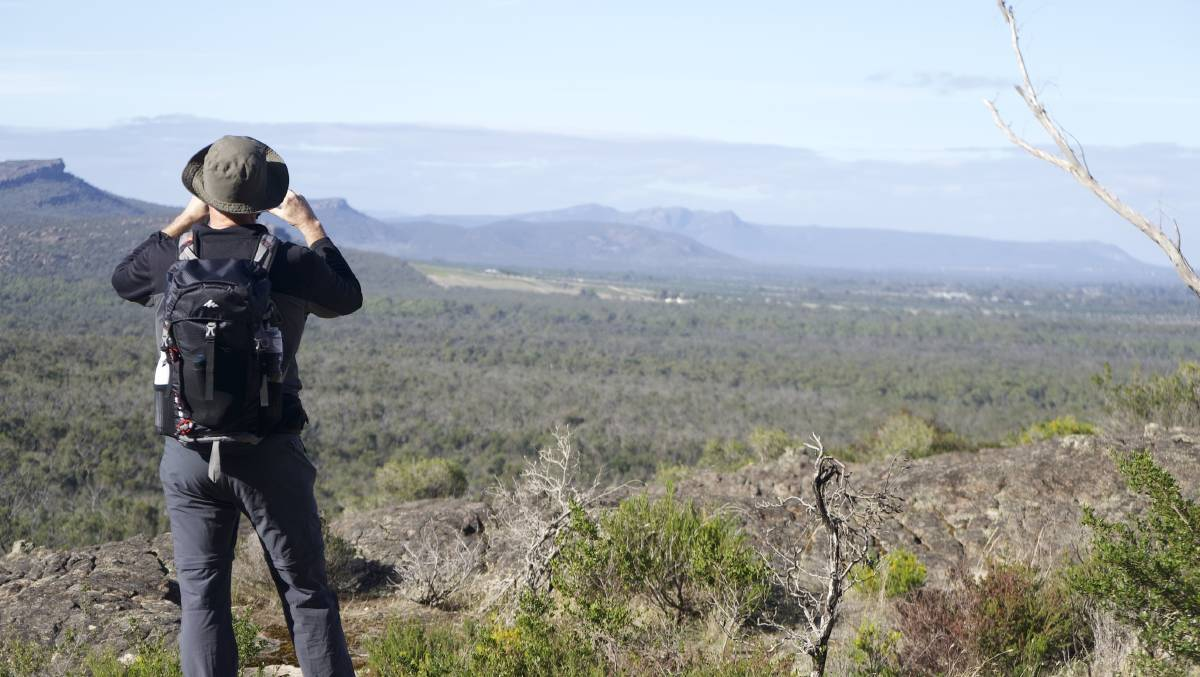 SCENIC LOOKOUT: Grampians Peaks Walking Company owner Adrian Manikas taking a photo. Picture: CONTRIBUTED
