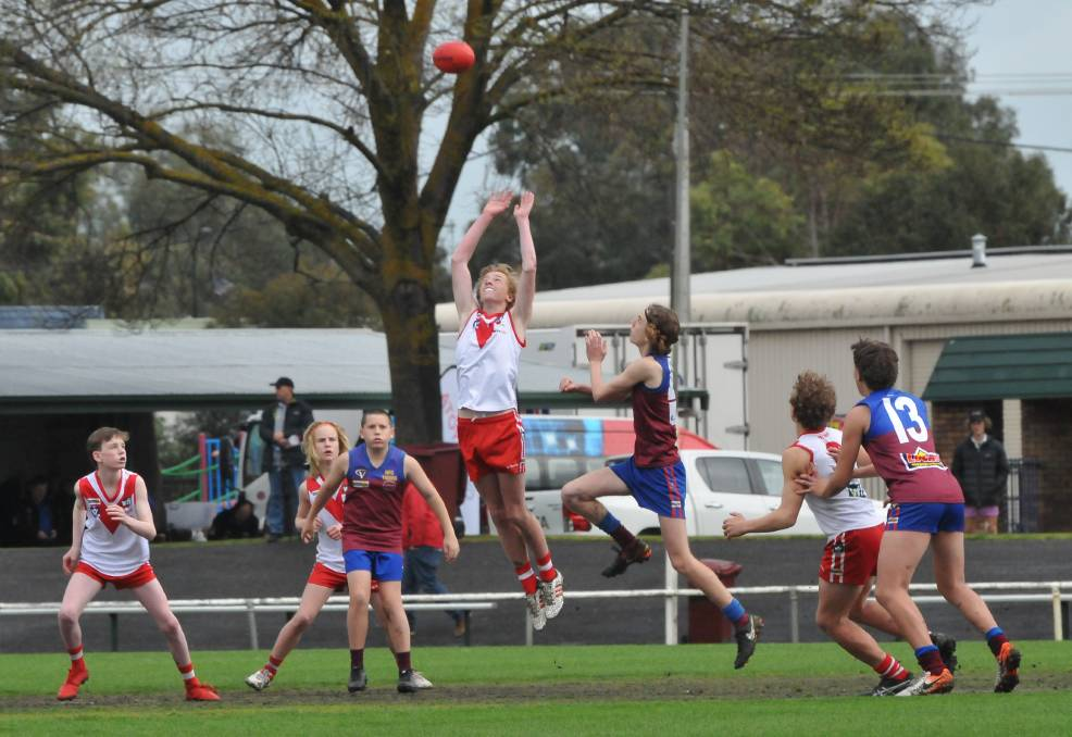 Ruckman fly during the Wimmera Football League's under-14 grand final.